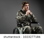 unhappy military man sitting in ... | Shutterstock . vector #1023277186