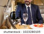 smiling bearded male sitting in ... | Shutterstock . vector #1023280105