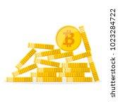 heap of the golden bitcoins in... | Shutterstock .eps vector #1023284722