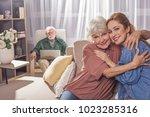 portrait of glad grandmother... | Shutterstock . vector #1023285316