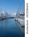 Small photo of Sailboats in Alimos Marina on a partially cloudy day