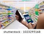 smart retail concept.female... | Shutterstock . vector #1023295168