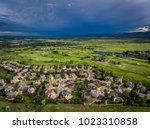 Storm clouds move in over a golf course and neighborhood in Lakewood, outside of Denver, Colorado.