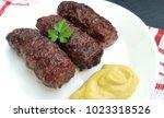 meat rolls  mititei or mici  ... | Shutterstock . vector #1023318526