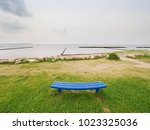 The Lonely Blue Bench On An...
