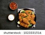 tasty crispy chicken wings with ...   Shutterstock . vector #1023331516