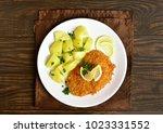 schnitzel with boiled potato on ... | Shutterstock . vector #1023331552