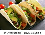 tacos with meat and vegetables. ... | Shutterstock . vector #1023331555