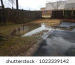 large water puddle in flooded...   Shutterstock . vector #1023339142