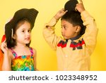 boy and girl children kids... | Shutterstock . vector #1023348952