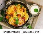 homemade chicken tikka biryani... | Shutterstock . vector #1023363145
