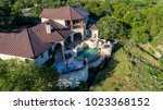 luxury mansion on large lot of... | Shutterstock . vector #1023368152
