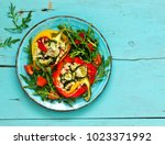 peppers stuffed with couscous... | Shutterstock . vector #1023371992