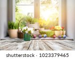 wooden table and sun | Shutterstock . vector #1023379465