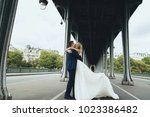 adorable wedding couple poses... | Shutterstock . vector #1023386482