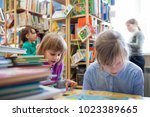 girls with books between... | Shutterstock . vector #1023389665