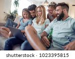 friends having fun at home... | Shutterstock . vector #1023395815