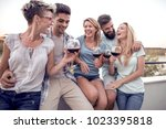 group of young friends having... | Shutterstock . vector #1023395818