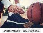basketball player tying sport... | Shutterstock . vector #1023405352