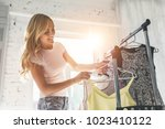 attractive young woman is...   Shutterstock . vector #1023410122