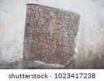 runestone built into the wall.... | Shutterstock . vector #1023417238