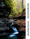 Small photo of A scenic, autumn view of some peaceful cascades at Buttermilk Falls State Park in Ithaca, New York.