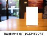 mock up menu frame standing on... | Shutterstock . vector #1023451078