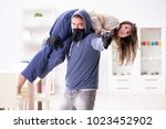 armed man assaulting young... | Shutterstock . vector #1023452902