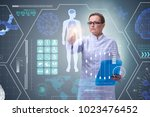 woman doctor in telemedicine... | Shutterstock . vector #1023476452