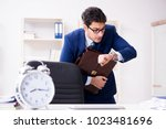businessman in rush trying to... | Shutterstock . vector #1023481696