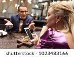 man proposing his girlfriend... | Shutterstock . vector #1023483166