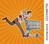 businessman pushing shopping... | Shutterstock .eps vector #1023488758