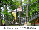 cute little girl having fun on... | Shutterstock . vector #1023489526