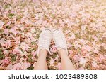 feet in white sneaker on the... | Shutterstock . vector #1023489808