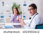 patient visiting doctor for... | Shutterstock . vector #1023502612