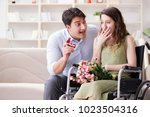 man making marriage proposal to ... | Shutterstock . vector #1023504316