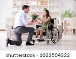 man making marriage proposal to ... | Shutterstock . vector #1023504322