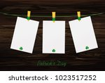 three blank paper with green...   Shutterstock .eps vector #1023517252