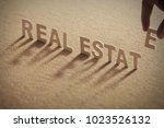 real estate wood word on... | Shutterstock . vector #1023526132