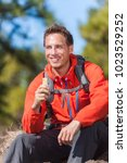 hiker man healthy outdoor... | Shutterstock . vector #1023529252