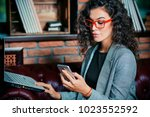 businesswoman is working with a ... | Shutterstock . vector #1023552592