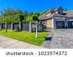 a perfect neighborhood. houses... | Shutterstock . vector #1023574372