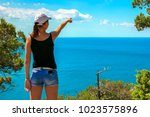 a young tourist girl stands on...   Shutterstock . vector #1023575896