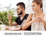 displeased jealous female sits... | Shutterstock . vector #1023581986