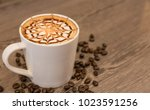 coffee cup topping with art... | Shutterstock . vector #1023591256