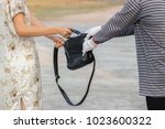 robbers are pulling a shopping... | Shutterstock . vector #1023600322