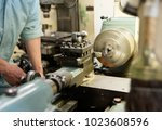 people working at a town factory | Shutterstock . vector #1023608596