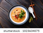 Stock photo tom yam kung spicy thai soup with shrimp seafood coconut milk and chili pepper in bowl 1023634075