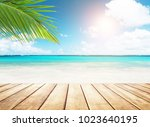 blurred blue sky and sea with... | Shutterstock . vector #1023640195