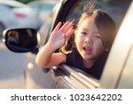 little asian girl waving hand... | Shutterstock . vector #1023642202